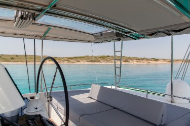 Sailing Charter Catamaran SERENITY Flybridge Helm and Seating