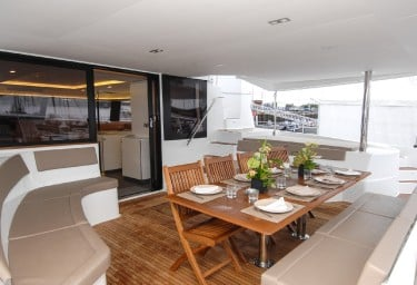 Charter Catamaran NENNE Aft Deck Dining Table