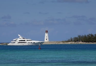 Luxury Charter Yacht Passing the Lighthouse