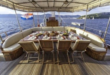 Luxury Charter Gulet LIBRA Aft Deck Dining Table