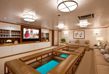 Luxury Expedition Yacht SURI Media Room with Glass Floor