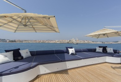 Luxury Yacht MOSAIQUE Bridge Deck with Sunpads for Onboard Relaxation